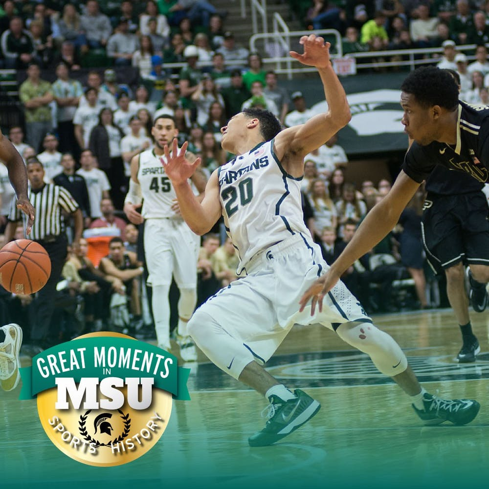 Then-senior guard Travis Trice gets hit by another player Mar. 4, 2015, during the game against Purdue at Breslin Center. The Spartans defeated the Boilermakers, 72-66. Photo by Emily Nagle. Design by Daena Faustino.