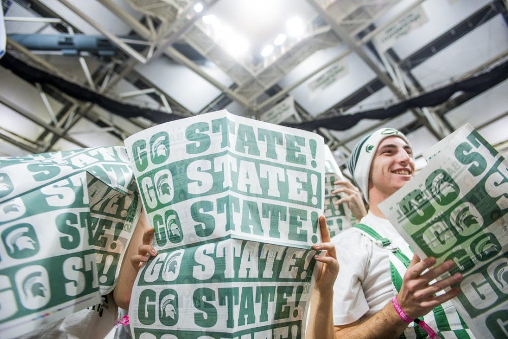 Students hold newspapers before the game against Penn State on Jan. 31, 2018 at Breslin Center. The Spartans beat the Nittany Lions 76-68.