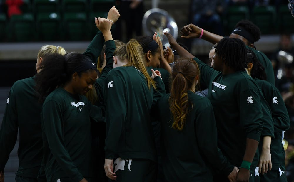 Michigan State starters come together at the beginning of their game against Hartford to chant and get ready. The Spartans crushed the Hawks, 79-34, on Nov. 24, 2019.