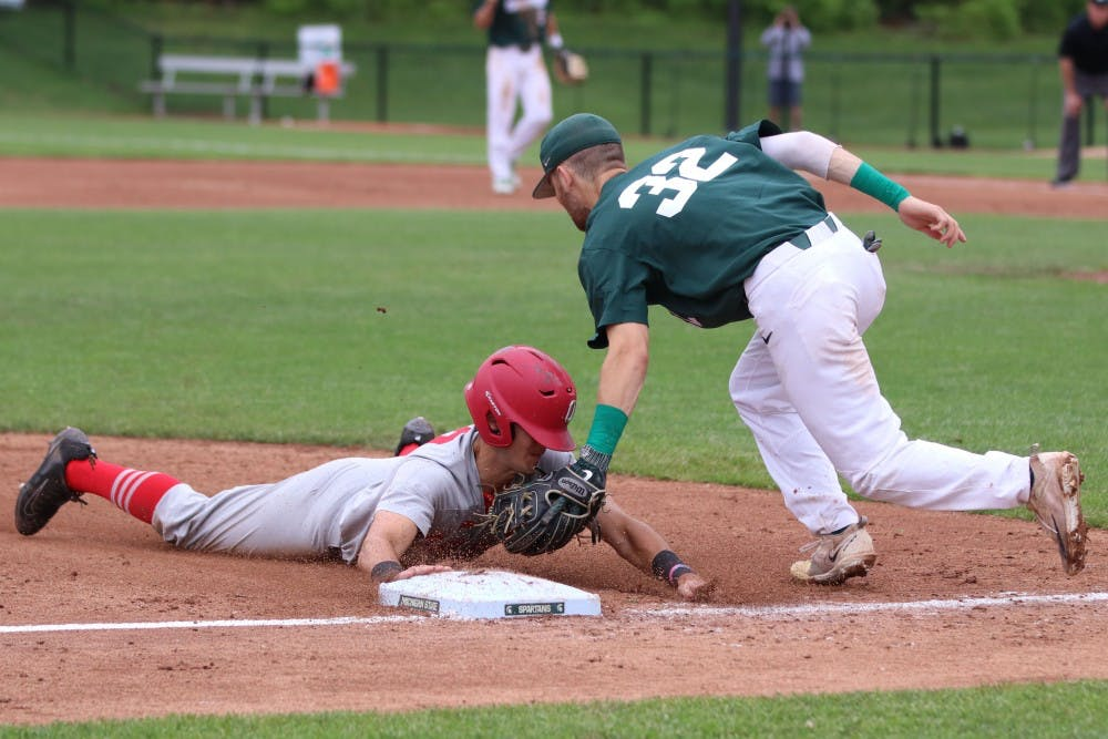Freshman infielder Zach Iverson (32) attempts to place a tag on an Ohio State runner on May 19, 2018 at McLane Baseball Stadium. The Spartans defeated the Buckeyes, 8-3.
