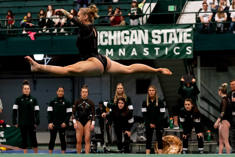 <p>Freshman Chloe Bellmore performs her floor routine during a meet against Nebraska. The Spartans fell to the Huskers, 196.550-197.100 on January 26 at Jenison Fieldhouse. </p>
