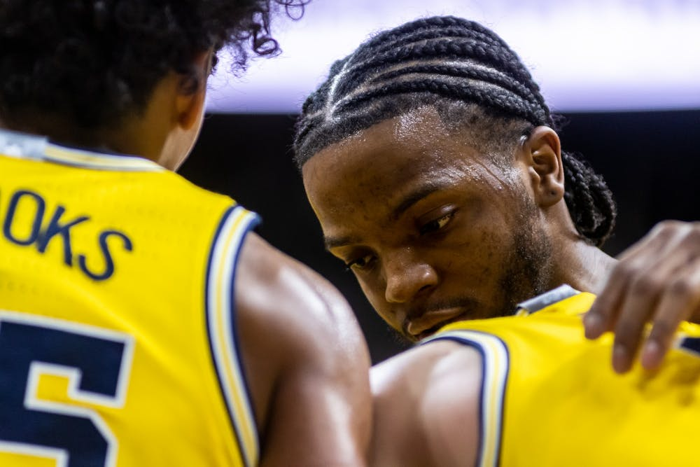 Michigan guard Zavier Simpson (right) talks to a teammate during a game against MSU.The Spartans defeated Michigan, 87-69, at the Breslin Student Events Center on January 5, 2020.