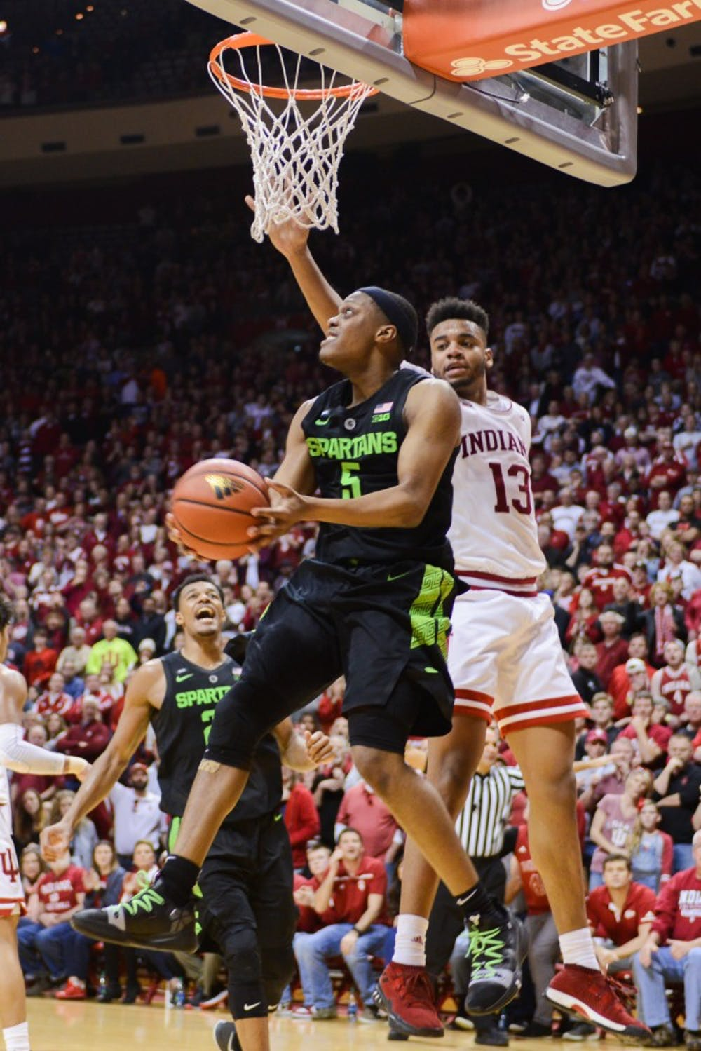 <p>Junior point guard Cassius Winston (5) looks for an open shot during the game against Indiana at the Bloomington Assembly Hall Mar. 2, 2019. The Spartans fell to the Hoosiers, 63-62.</p>