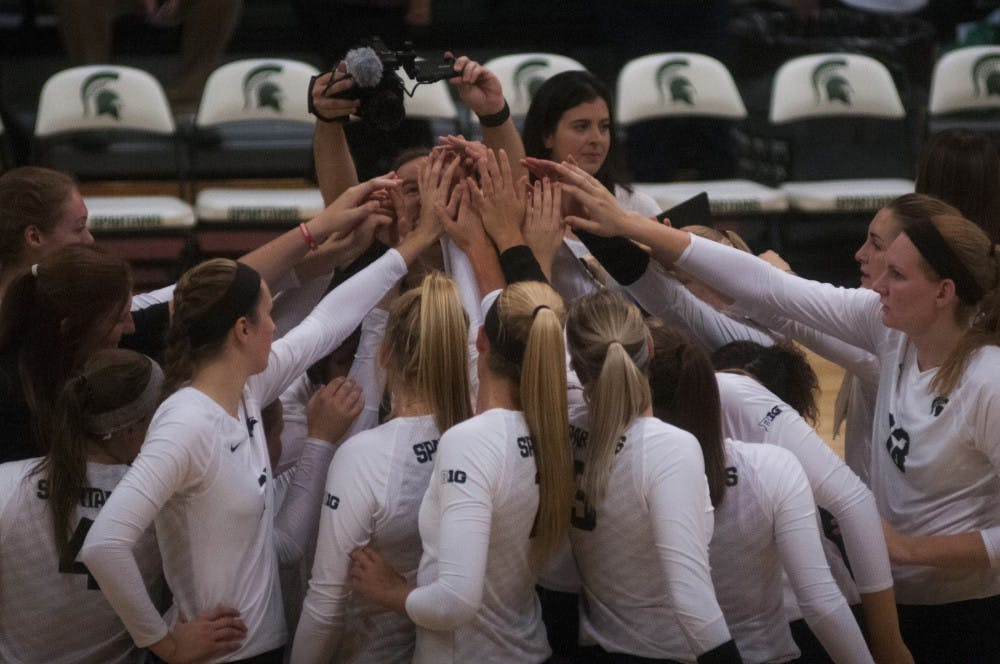 The volleyball team puts their hands together during the volleyball game against Notre Dame on Sept. 16, 2016 at the Jenison Field House. The Spartans defeated the Fighting Irish, 3-0.