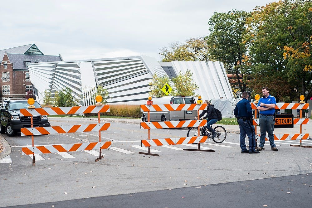 <p>MSU Police block off East Circle Drive Oct. 14, 2014, for the construction and setting up of the Batman vs. Superman: Dawn of Justice movie to be filmed at the Eli and Edythe Broad Art Museum. CATA buses had to be rerouted to work around the block off. Erin Hampton/The State News</p>