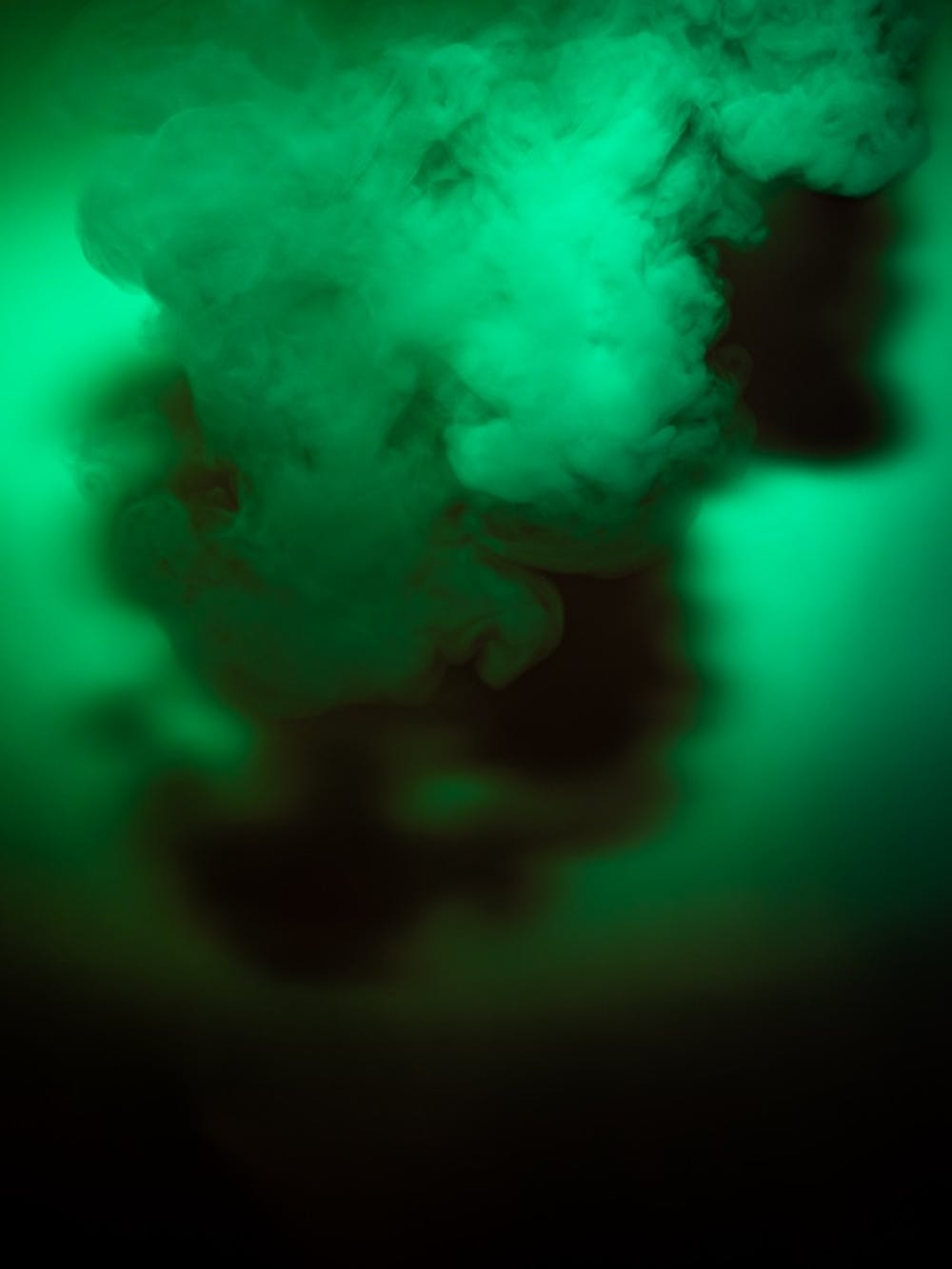 <p>A cloud of vapor underneath green light. Photographed on Oct. 21, 2019.</p>