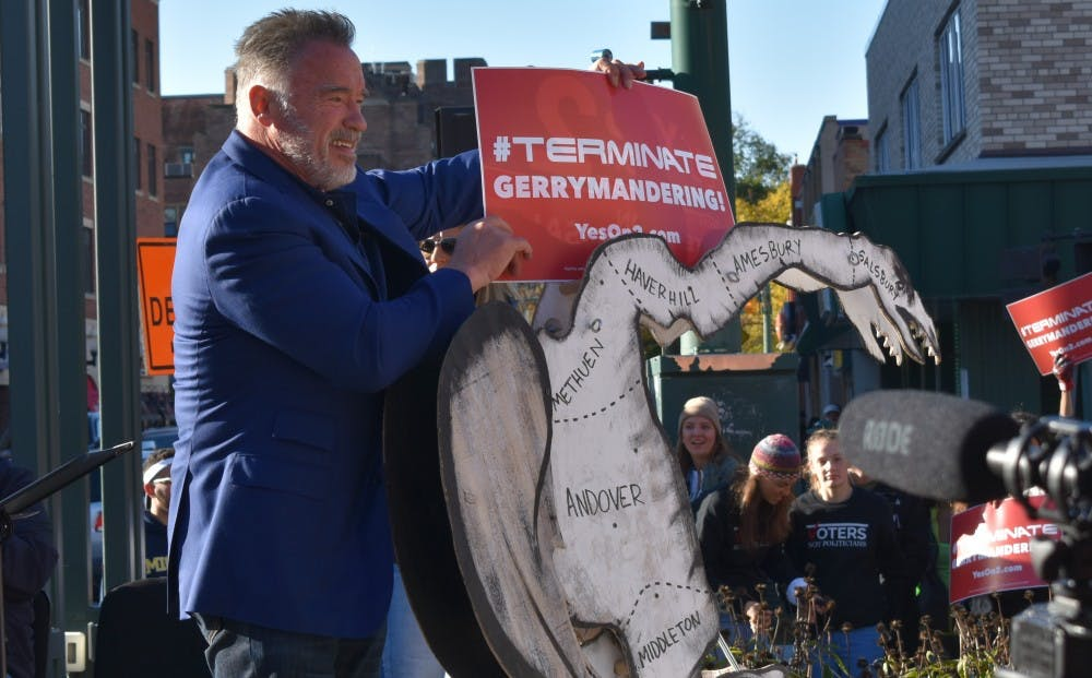 Former California Governor Arnold Schwarzenegger poses with a model of what is considered the first gerrymandered district in the United States on Oct. 20.