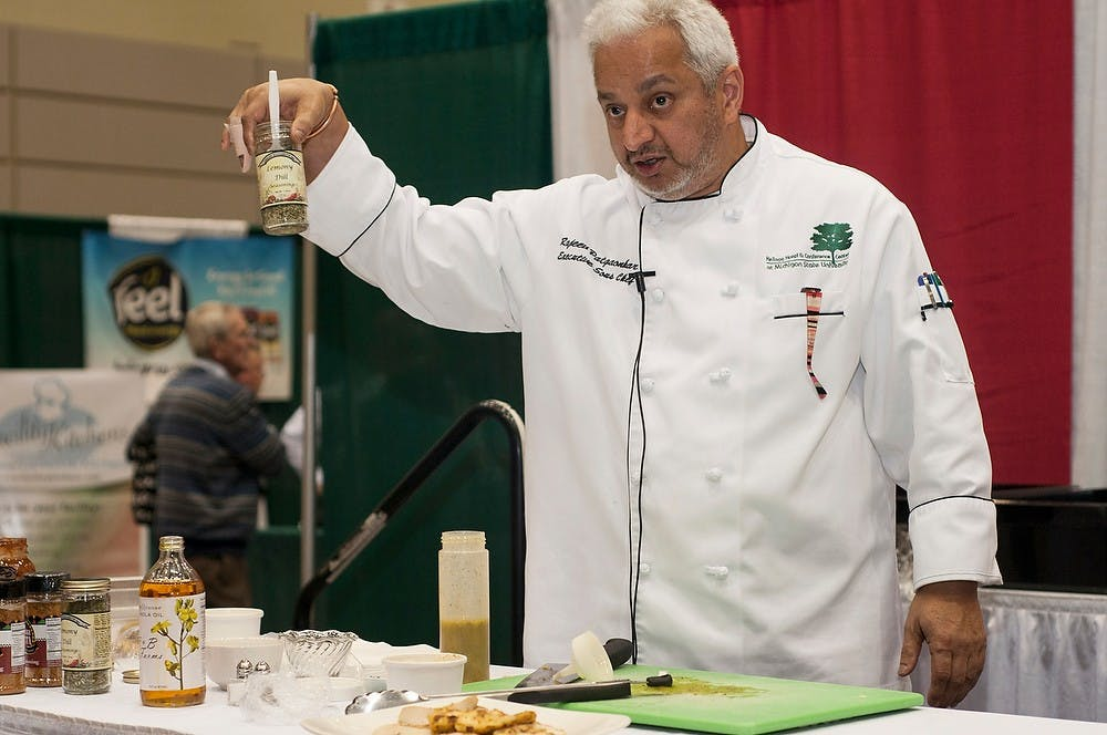 <p>Executive Sous Chef Rajeev Patgaonkar does a cooking presentation during the sixth annual Making It In Michigan Conference and Premier Specialty Food Show on Nov. 12, 2013, at the Lansing Center. Patgaonkar created foods with ingredients that he chose from the show and plans on using some of them in dishes in the Kellogg Center kitchen. Margaux Forster/The State News</p>