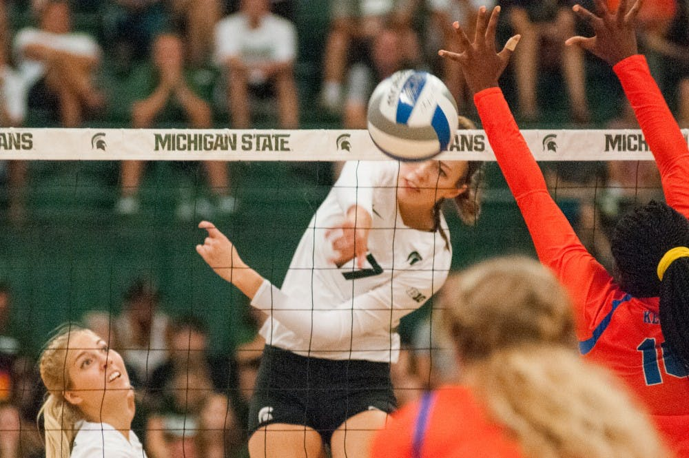 Junior middle blocker Alyssa Garvelink (17) hits the volleyball during the volleyball game against the University of Florida on Sept. 4, 2016 at Jenison Field House. The Spartans were defeated by the Gators, 3-0.