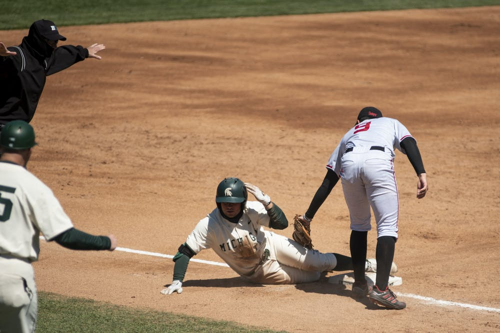 Freshman infielder Trent Farquhar (1) safe after sliding into third base during the game against Nebraska on April 25, 2021, at the McLane Stadium. The Cornhuskers defeated the Spartans 9-6.