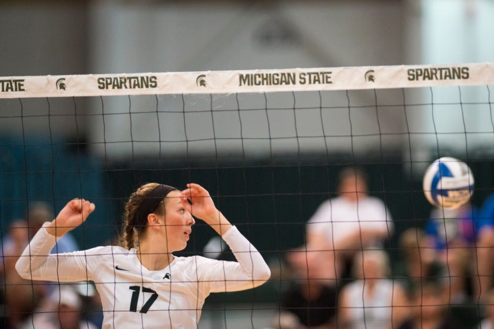 Junior middle blocker Alyssa Garvelink (17) fails to make contact with the volleyball during the volleyball game against the University of Florida on Sept. 4, 2016 at Jenison Field House. The Spartans were defeated by the Gators, 3-0.