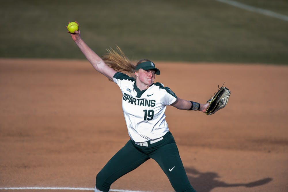 <p>Sophomore pitcher Alli Walker (19) winds up during the game against Oakland on April 3, 2019 at Secchia Stadium. The Spartans beat the Golden Grizzlies, 11-3.</p>