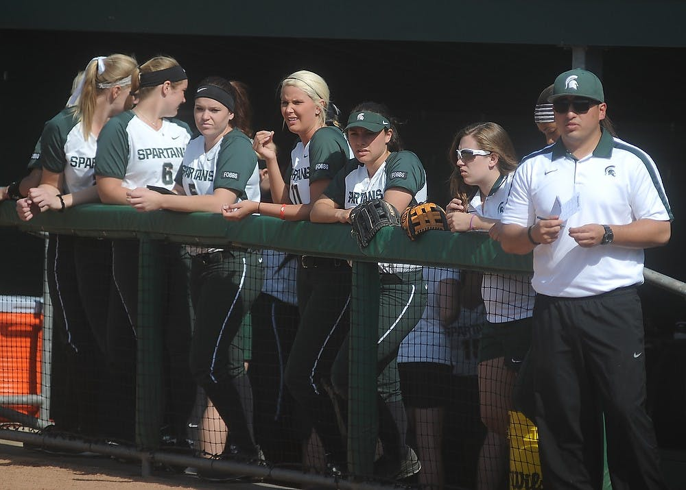 <p>The team watches the field April 17, 2015, during a game against Minnesota at Secchia Softball Stadium. The Spartans were defeated by the Golden Gophers, 8-4. Alice Kole/The State News</p>