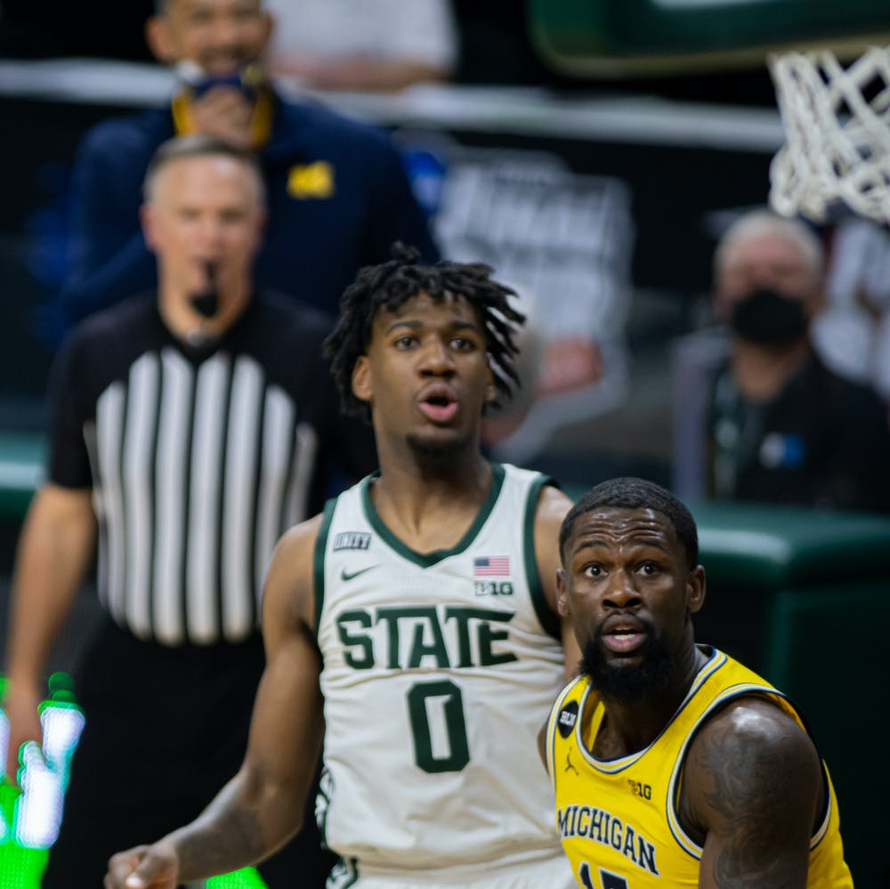 <p>Senior guard Chaundee Brown Jr. and junior forward Aaron Henry watch Henry&#x27;s shot fall into the basket during warmups. The Spartans upset the No. 2 Wolverines 70-64 on March 7, 2021.</p>