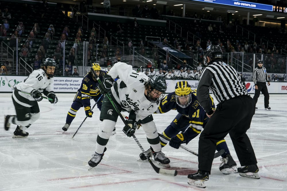 <p>Senior forward Tommy Apap (11) faces off against Michigan on Jan. 9, 2021, at Munn Ice Arena. The Spartans defeated the Wolverines, 3-2. </p>