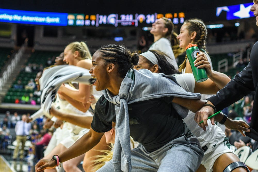 The Spartans celebrate during the game against Morehead State at Breslin Center on Dec. 15, 2019. The Spartans defeated the Eagles, 93-48.