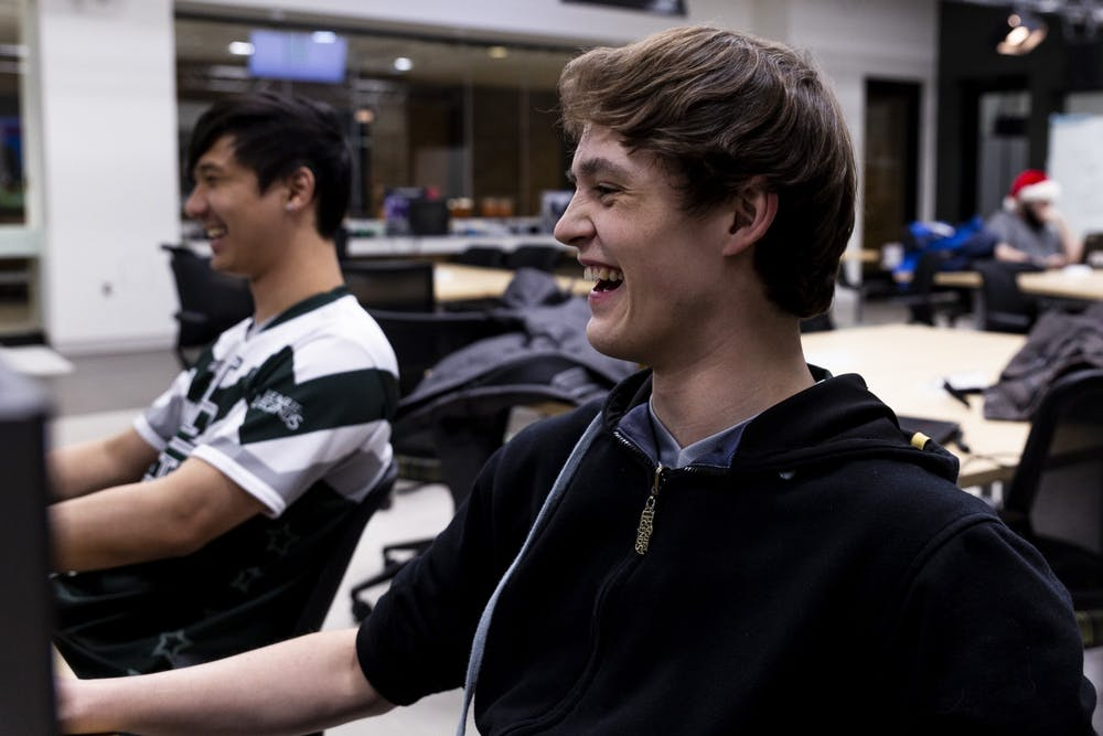 <p>Ryan Felten laughs with teammates while playing League of Legends on Dec. 2, 2019 at Communication Arts Building. </p>