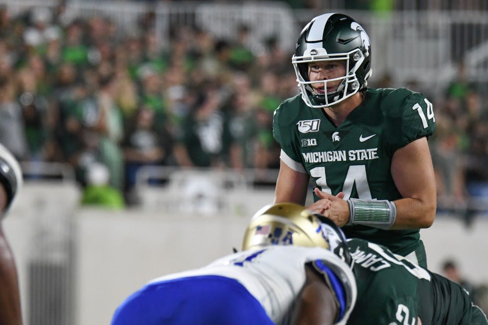Redshirt senior quarterback Brian Lewerke (14) takes the snap during the game against Tulsa at Spartan Stadium Aug. 30, 2019. The Spartans defeated the Golden Hurricane, 28-7.