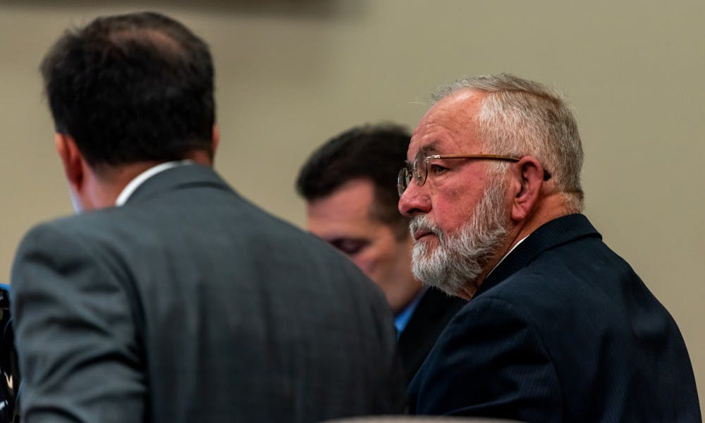 <p>Dr. William Strampel (right), former dean of the MSU College of Osteopathic Medicine, on trial at the Ingham Count Circuit Court on June 4, 2019.</p>