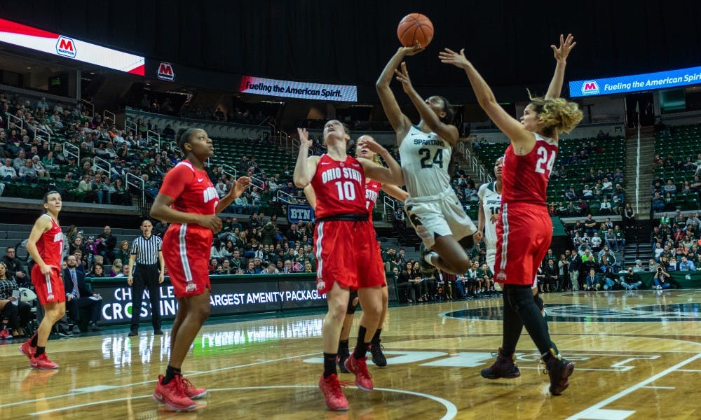 <p>Freshman guard Nia Clouden (24) drives to the basket on Ohio State's Carly Santoro. The Spartans lost to the Buckeyes, 70-77, on Feb. 21, 2019 at the Breslin Center.</p>