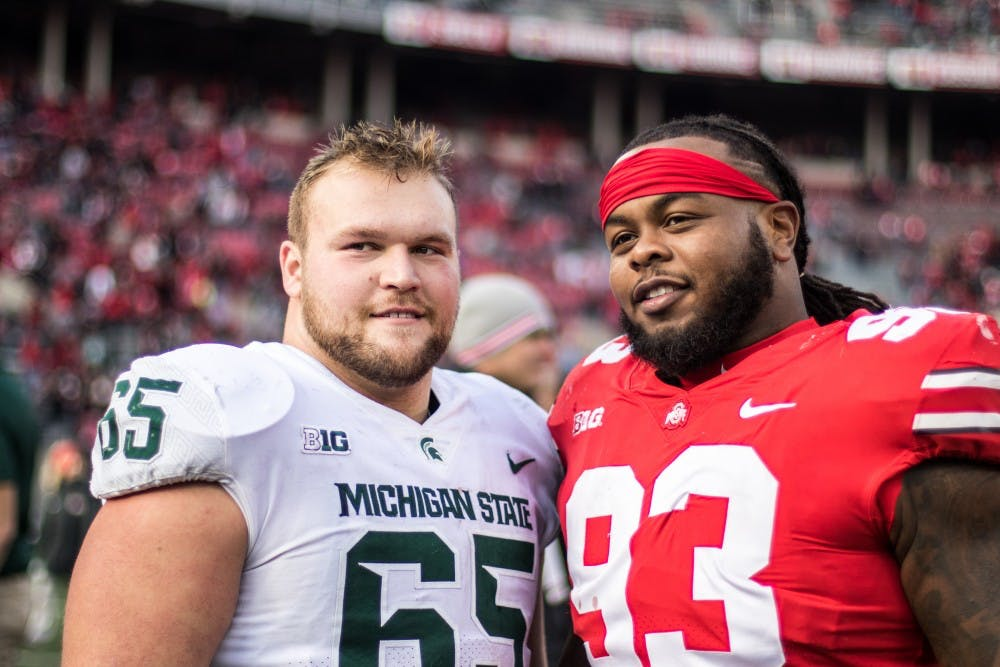 <p>Then- offensive lineman Brian Allen (65) is pictured with then-Ohio State defensive tackle Tracy Sprinkle after the Ohio State game on Nov. 11, 2017</p>
