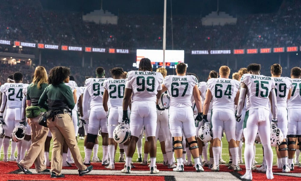 Spartan football players stand for the national anthem before playing Ohio State. The Buckeyes defeated the Spartans, 34-10, at Ohio Stadium on October 5, 2019.