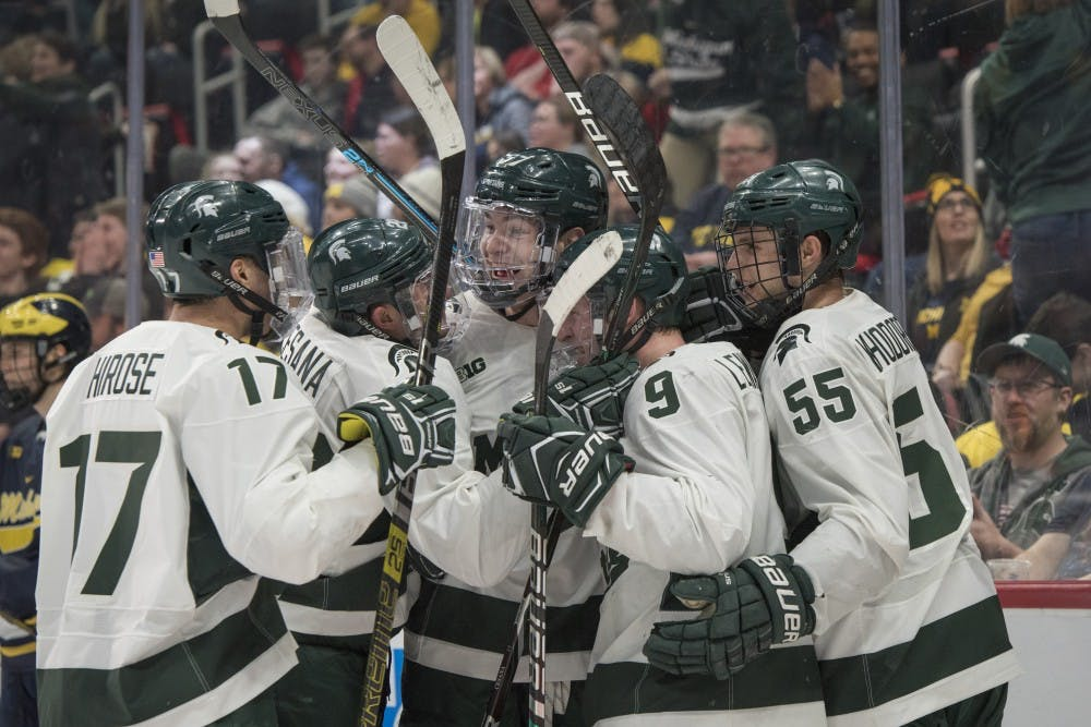 The Spartans celebrate a goal during the Duel in the D at Little Caesars Arena in Detroit on Feb. 9, 2019. Michigan defeated Michigan State 5-2. Nic Antaya/The State News