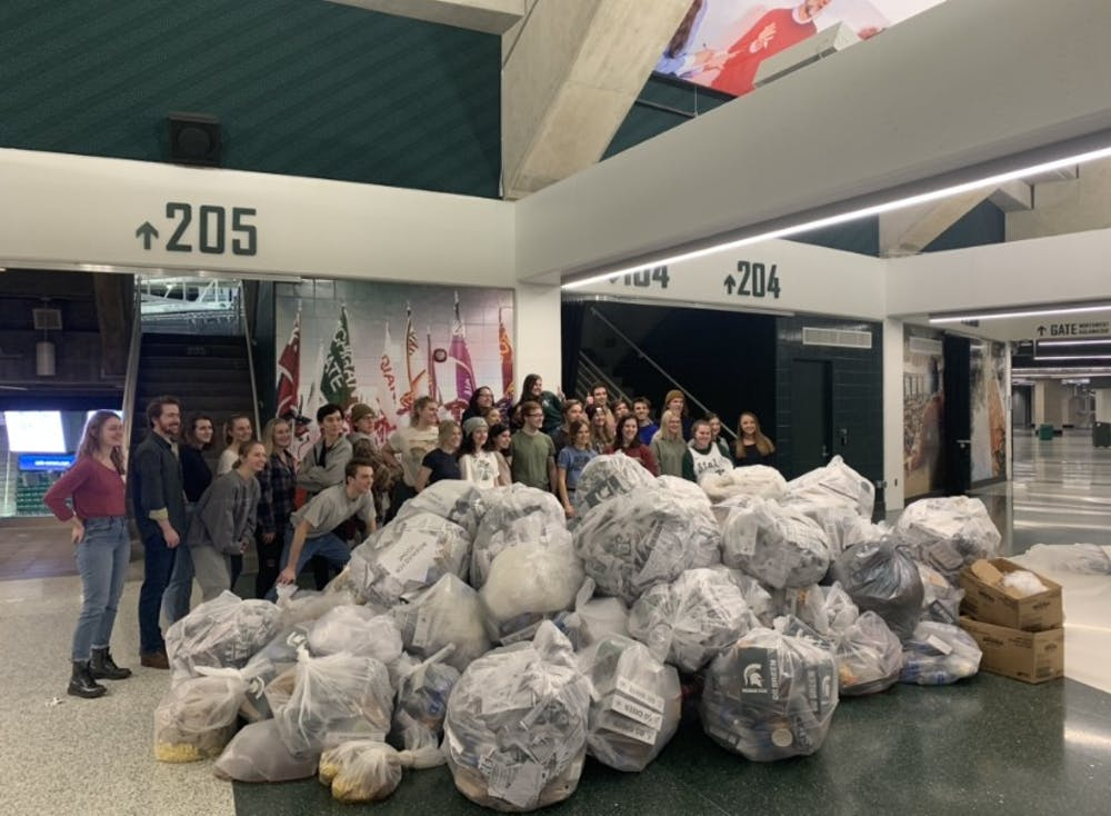 <p>Volunteers pose with the collected bags of recyclables and compost after the Breslin Recycling Sweep on Jan. 29. </p>