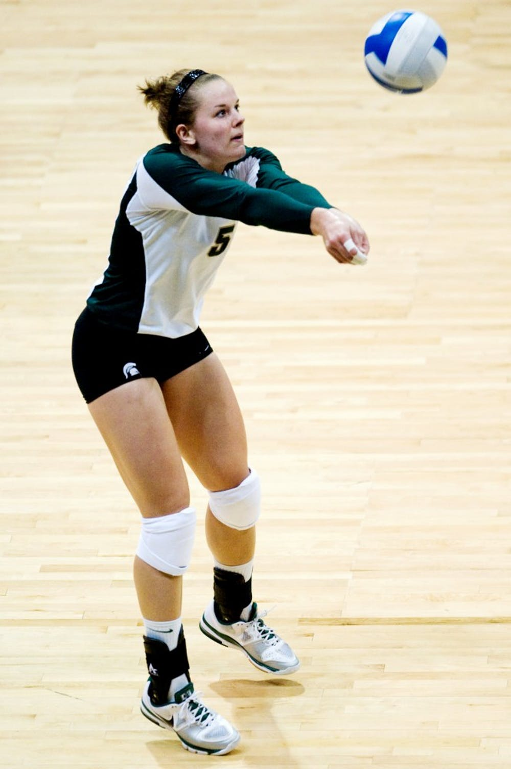 Senior outside hitter Jenilee Rathje bumps the ball during Saturday's game against Minnesota at Jenison Field House. Lauren Wood/The State News