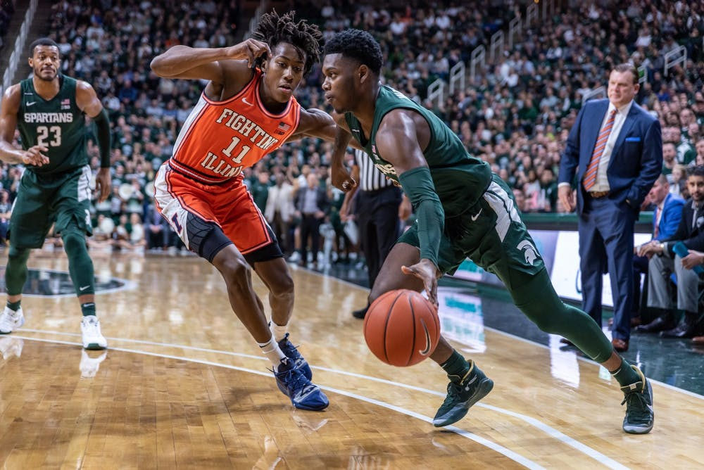 <p>Freshman guard Rocket Watts (right) drives on Illinois guard Ayo Dosunmu (left). The Spartans defeated the Illini, 76-56, at the Breslin Student Events Center on January 2, 2020.</p>