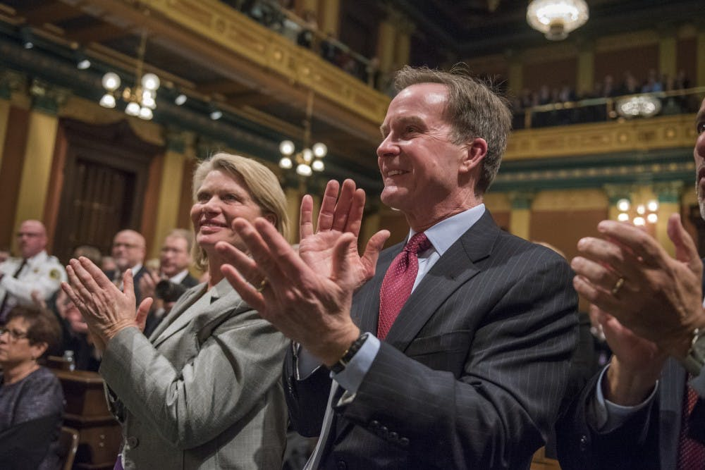 Michigan Attorney General Bill Schuette claps as Gov. Rick Snyder addresses the audience during the State of the State Address on Jan. 23, 2018 at the Capitol in Lansing. (Nic Antaya | The State News)