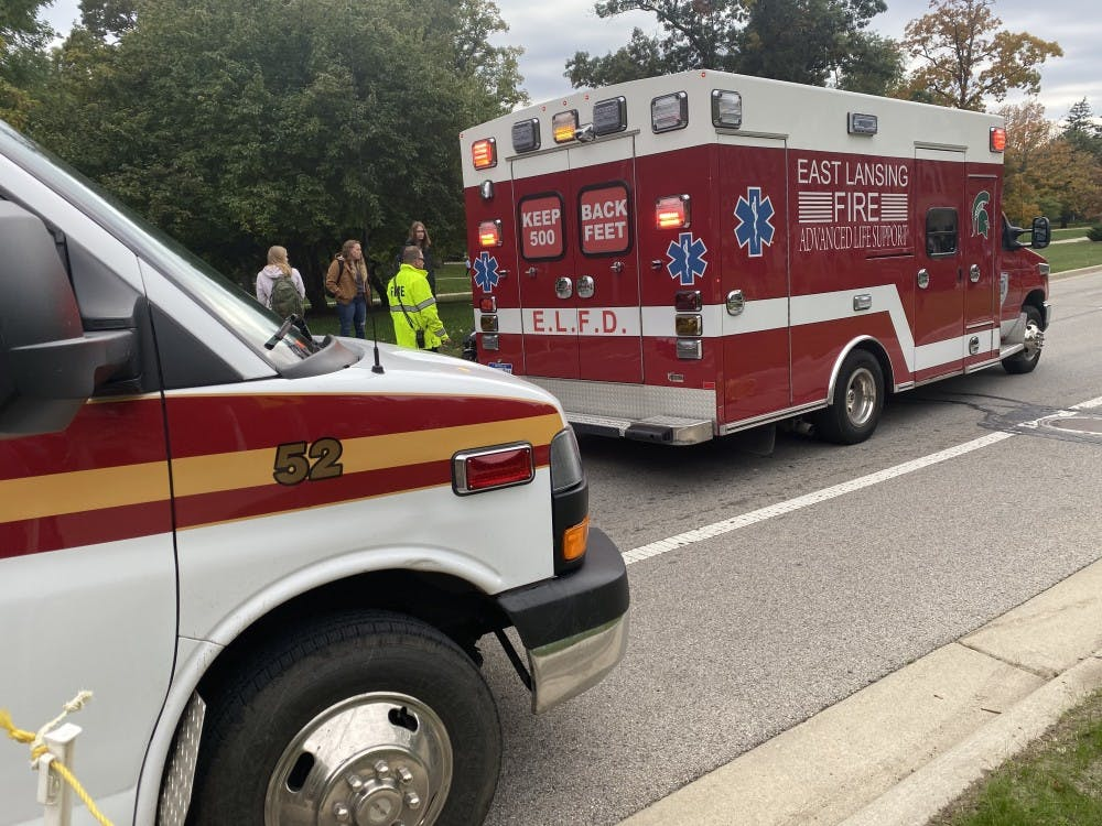 EMTs respond to a moped accident on West Circle Road on Oct. 15, 2019. One female riding a bike collided with one riding a moped.
