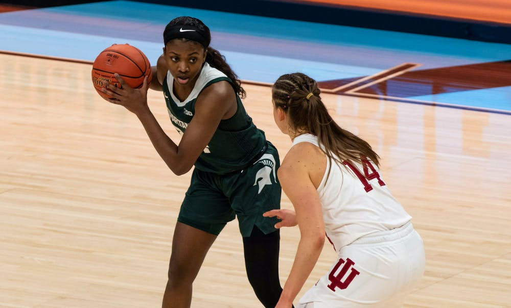 <p>Junior guard Nia Clouden (24) stares down an Indiana player during the first quarter of the game. The Spartans will advance to the semifinals of the Big Ten Tournament after defeating the Hoosiers, 69-61, at Bankers Life Fieldhouse. Shot on March 11, 2021.</p>