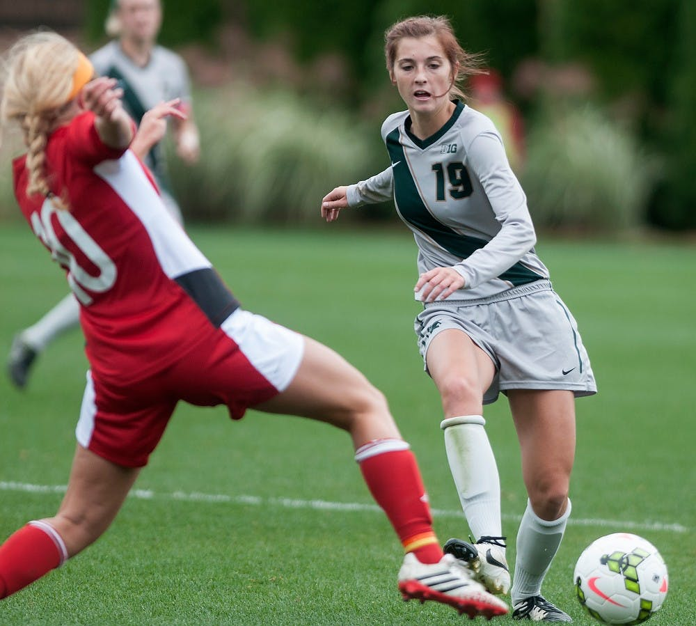 <p>Nebraska midfielder Courtney Claassen tries to steal the ball from sophomore midfielder Marisa Oleksiak during the game against Nebraska on Oct. 5, 2014, at DeMartin Soccer Stadium at Old College Field. The Spartans defeated the Cornhuskers, 3-1. Jessalyn Tamez/The State News</p>