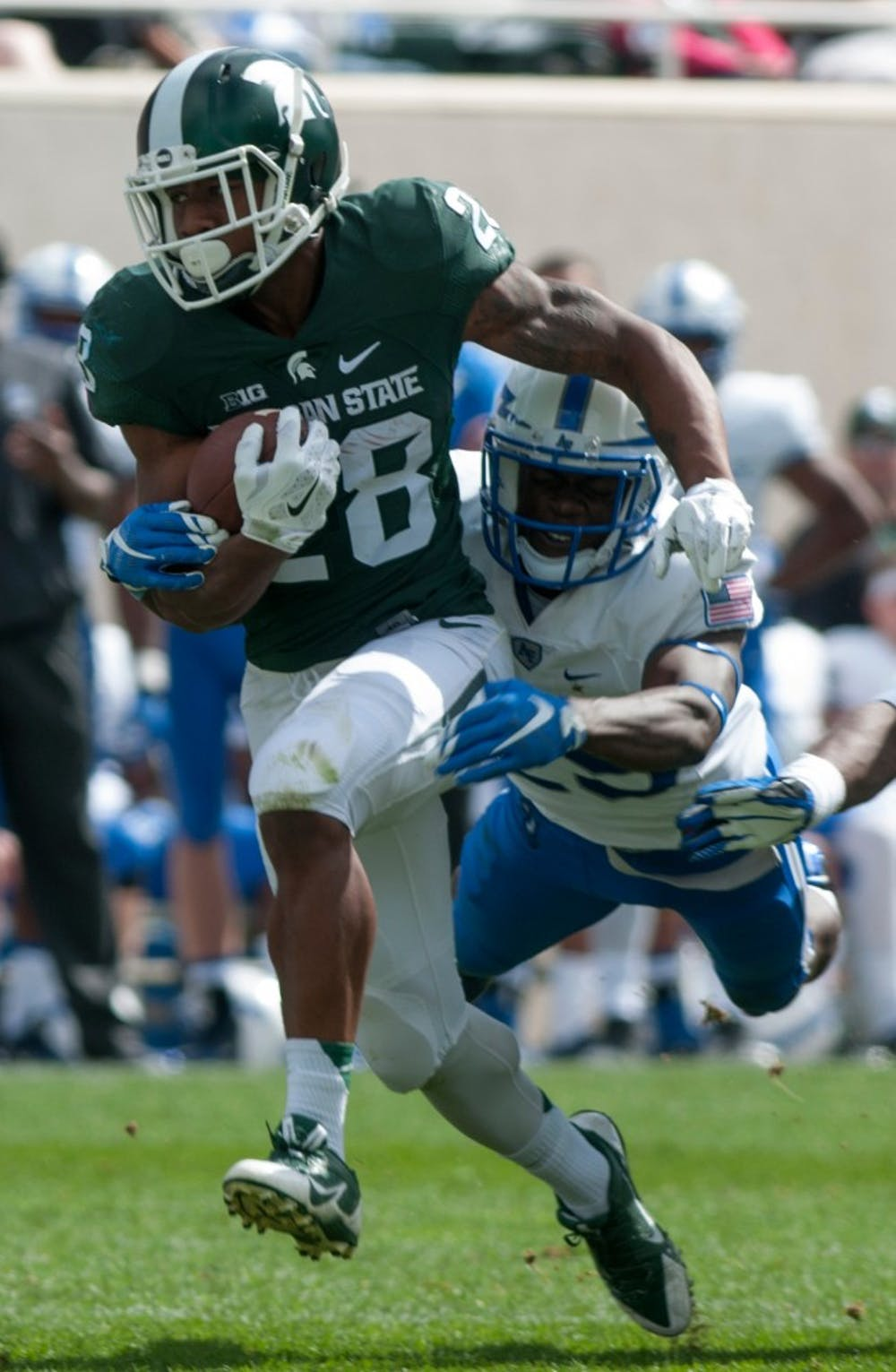 <p>Air Force's defensive back Roland Ladipo tackles redshirt freshman running back Madre London runs the ball in the first half during the game against Air Force on Sept. 19, 2015 at Spartan Stadium. The Spartans defeated the Falcons, 35-21. Kennedy Thatch/The State News</p>