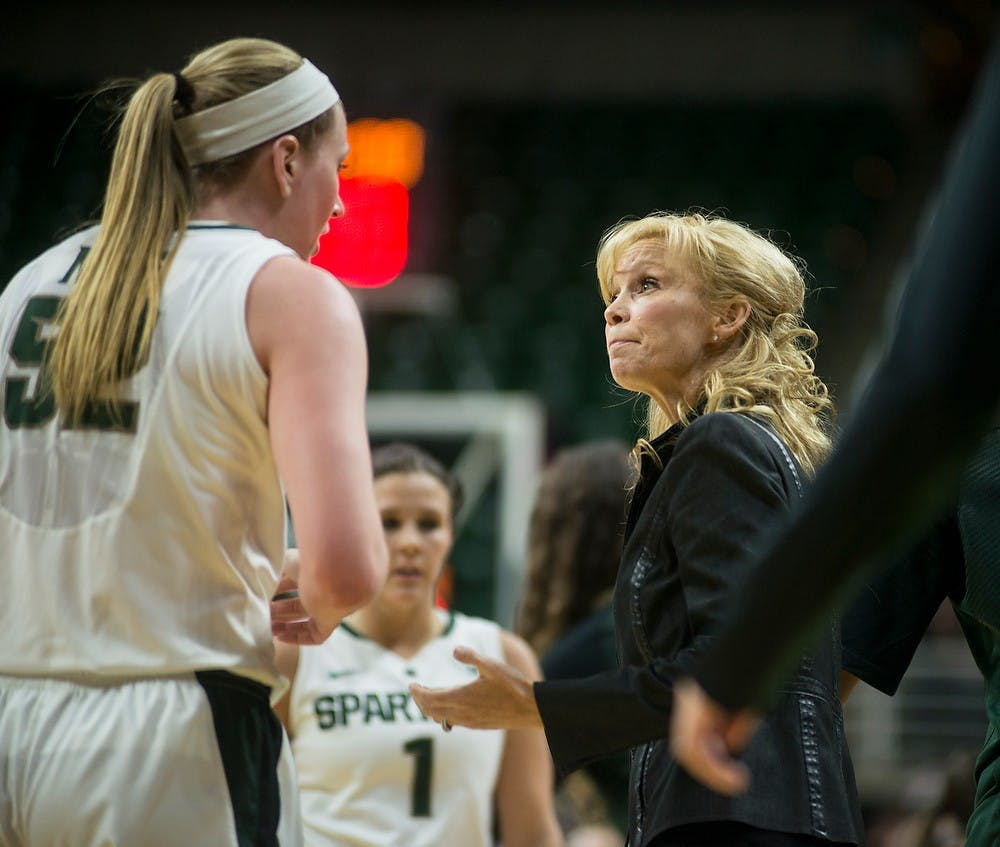 <p>Head coach Suzy Merchant talks with senior forwar Becca Mills before a timeout Jan. 8, 2015, during the game against Nebraska at Breslin Center. The Spartans were defeated by the Huskers, 71-67. Erin Hampton/The State News</p>