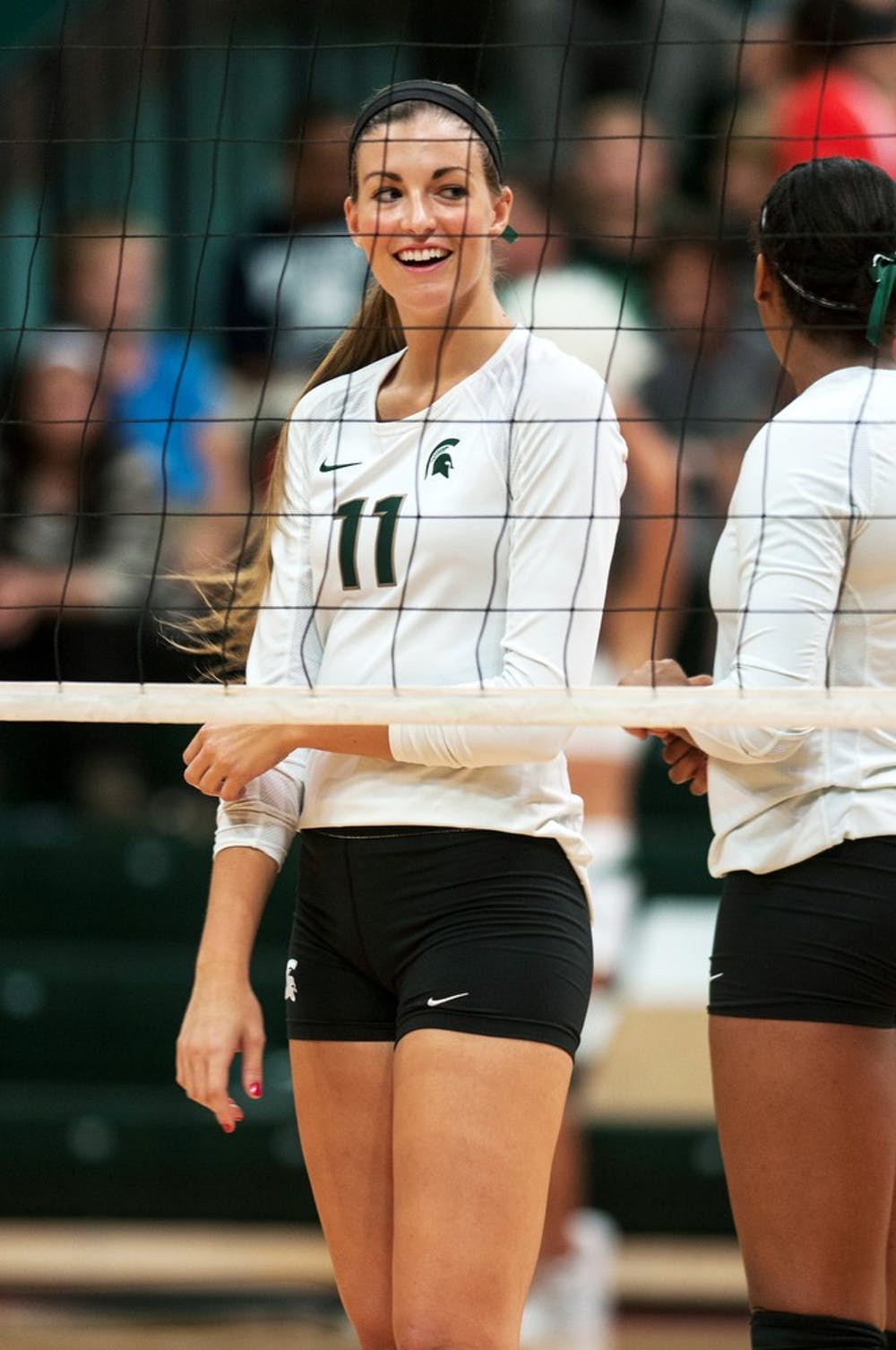 "<p>Freshman Chloe Reinig gets congratulated on a play, Sept. 21, 2013, at Jenison Field House. <span class=""caps"">MSU</span> beat Cincinnati, 3-0. Margaux Forster/The State News</p>"