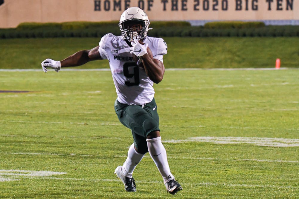 Junior running back Kenneth Walker III finds the open field during the Spartans game against Northwestern on Friday, Sep. 3.