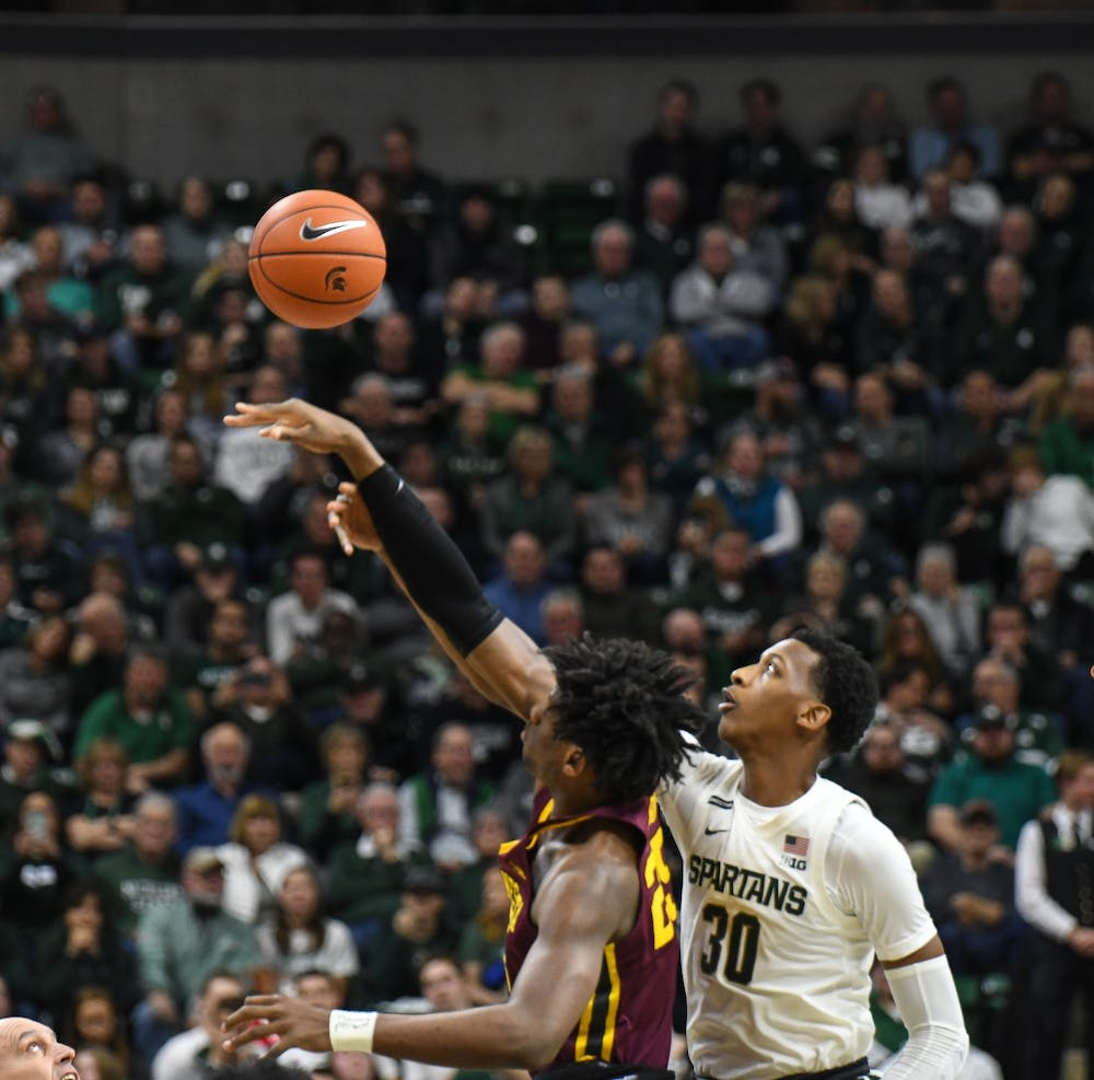 Sophomore forward Marcus Bingham Jr. (30) reaches for the ball during the game against Minnesota at the Breslin Center on January 9, 2020. The Spartans defeated the Golden Gophers 74-58.