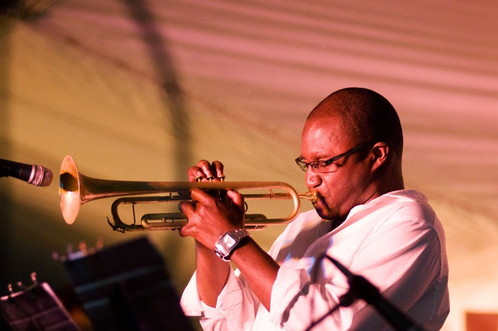 <p>Keaton Akins of the Evidence jazz group plays a trumpet solo Saturday evening at the Summer Solstice Jazz Festival in downtown East Lansing. Akins and his band from Grand Rapids, Mich. performed in between the main acts all day Saturday. Sam Mikalonis/The State News</p>