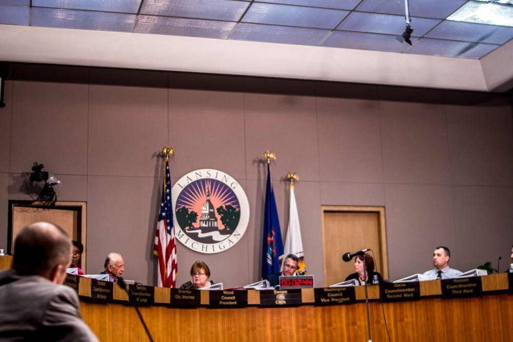 City council members take a moment to deliberate during the city council meeting on March 26, 2018 at the East Lansing City Hall. Residents and pro-marijuana activists gathered to voice their concern over medical marijuana dispensaries being denied operational rights in the city of Lansing.
