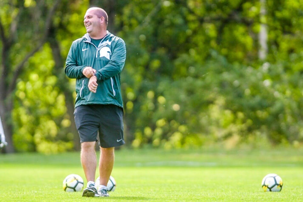 Head Coach Damon Rensing laughs during practice on Oct. 10, 2017 at DeMartin Stadium. Rensing has reached his 100th career win as head coach at MSU.
