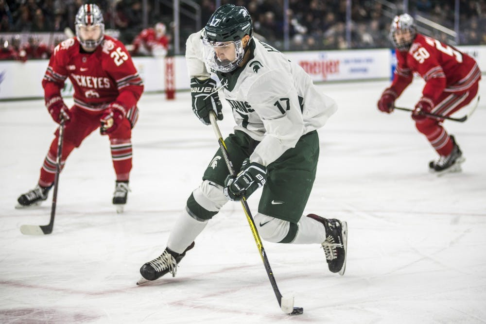 Sophomore left wing Taro Hirose (17) handles the puck during the first period of the men's hockey game against Ohio State on Jan. 5, 2018 at the Munn Ice Arena. (Nic Antaya | The State News)
