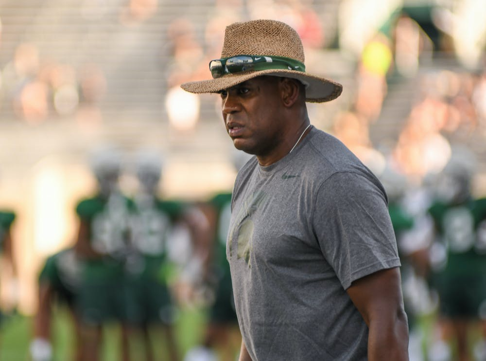 <p>Michigan State Head Coach Mel Tucker analyzes the field during the Meet the Spartans event.</p>