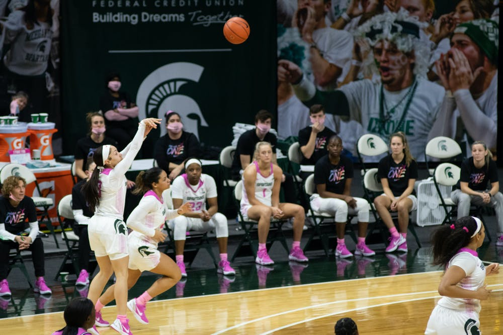 <p>Alyza Winston (3) shoots a 3-point shot in the Spartans&#x27; victory over Purdue on Feb. 21, 2021.</p>