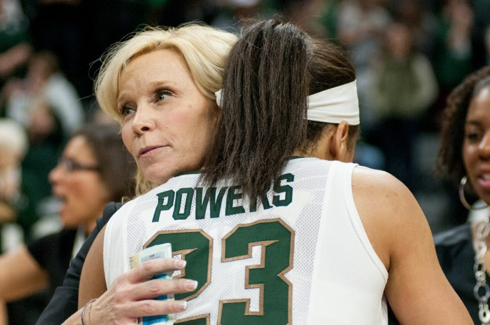 Junior guard Aerial Powers embraces head coach Suzy Merchant after the game against Ohio State on Feb. 27, 2016 at Breslin Center. The Spartans defeated the Buckeyes, 107-105 in triple overtime.
