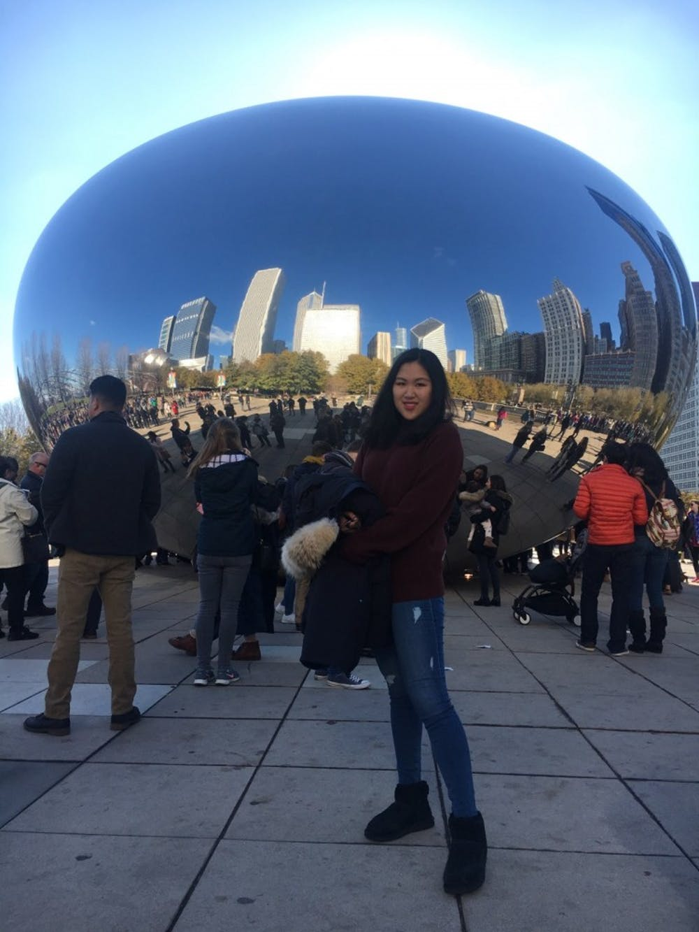 Echo Huan, an MSU junior in the studio arts and finance major from Beijing, China, poses in front of the famous Cloud Gate sculpture on a recent Thanksgiving trip to Chicago.  Photo courtesy of Echo Huan