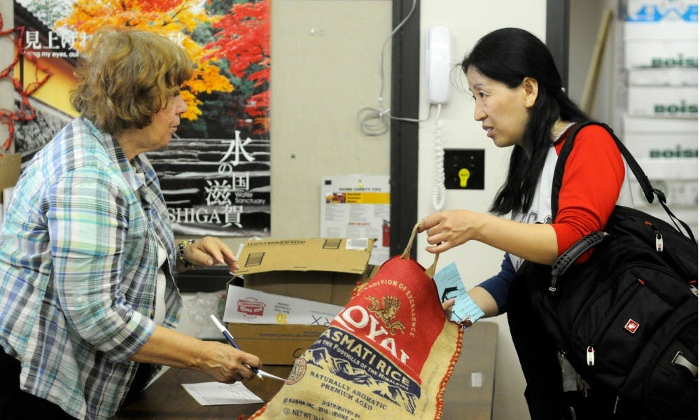 <p>Doctoral student Sun Yanxiang, right, checks out Sept. 17, 2015, at the Lending Center in Spartan Village. The Lending Center is a second hand store used to help international students with home necessities and is closing this spring.</p>