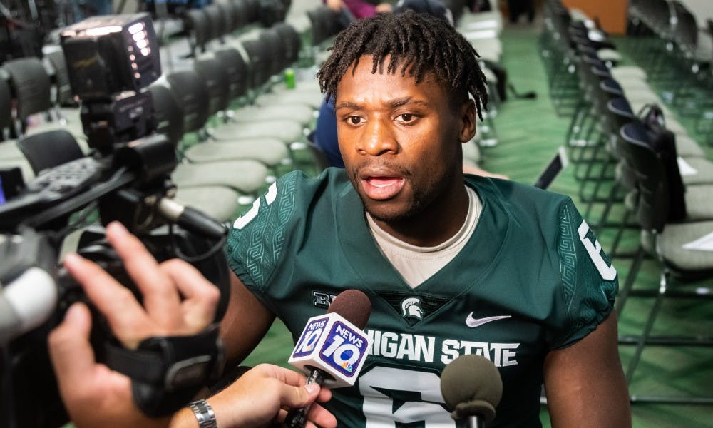 <p>Senior safety David Dowell speaks to the press during Michigan State's Football Media Day at Spartan Stadium on Aug. 5, 2019. </p>