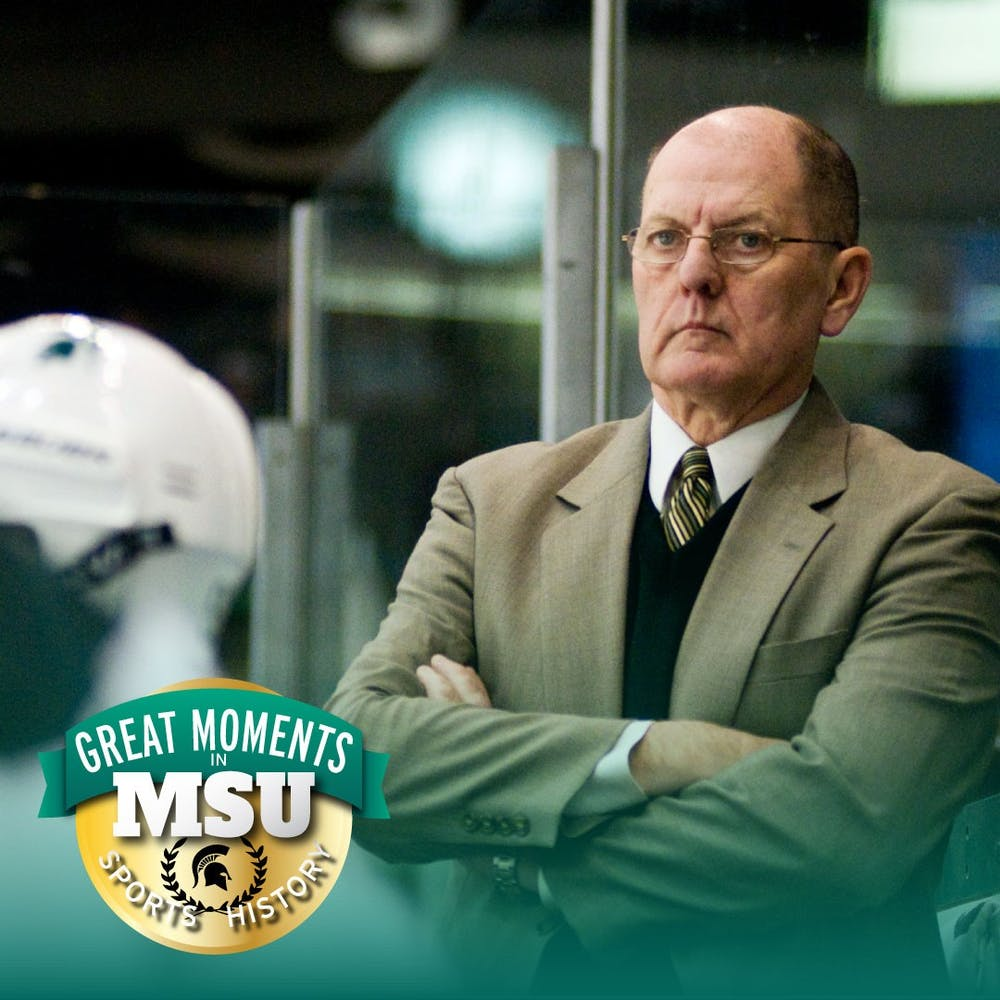 Despite his team being ahead, then-coach Rick Comley remains composed as his players score three goals in the first period Feb. 12, 2011 at Munn Ice Arena. State News file photo. Design by Daena Faustino.